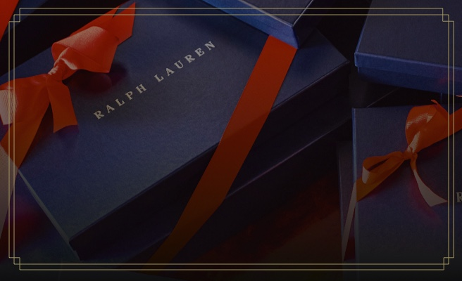 Navy Ralph Lauren gift box tied with red ribbon
