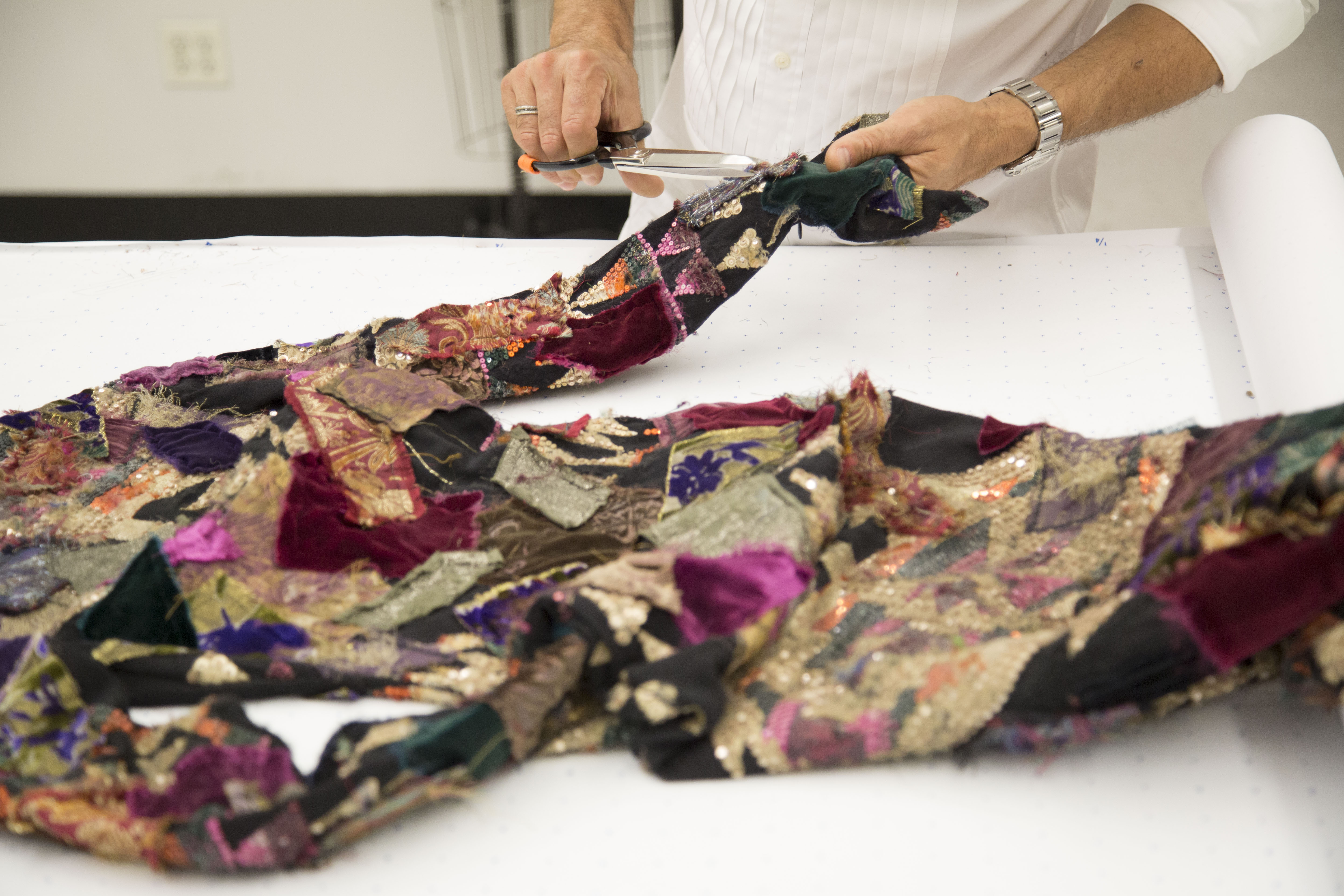 A skilled artisan works on the patchwork pattern of the Hamlin dress from the Ralph Lauren 50th Anniversary Collection