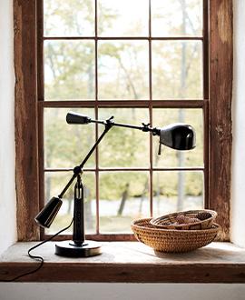Black swing-arm desk lamp