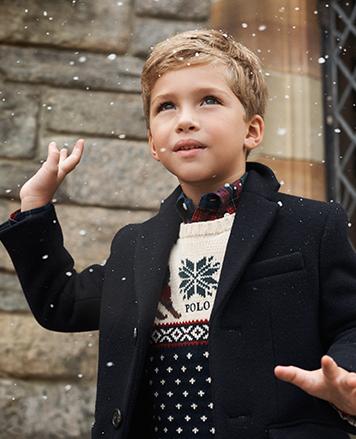 Boy wears jacket over Ski Bear sweater.