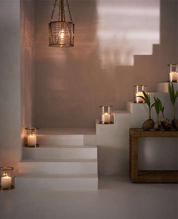 Candles In Glass Vessels Along Staircase