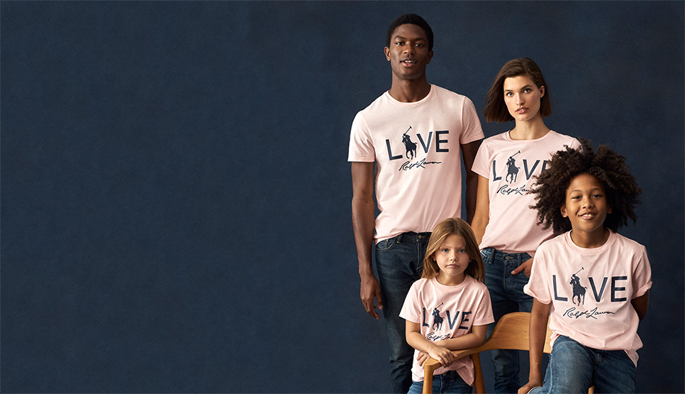 Photograph of adults & kids in pink Live Love tees
