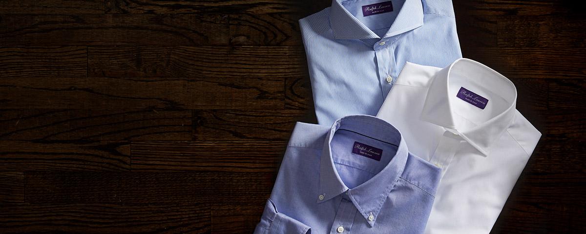 Folded dress shirts in light blue, violet & white