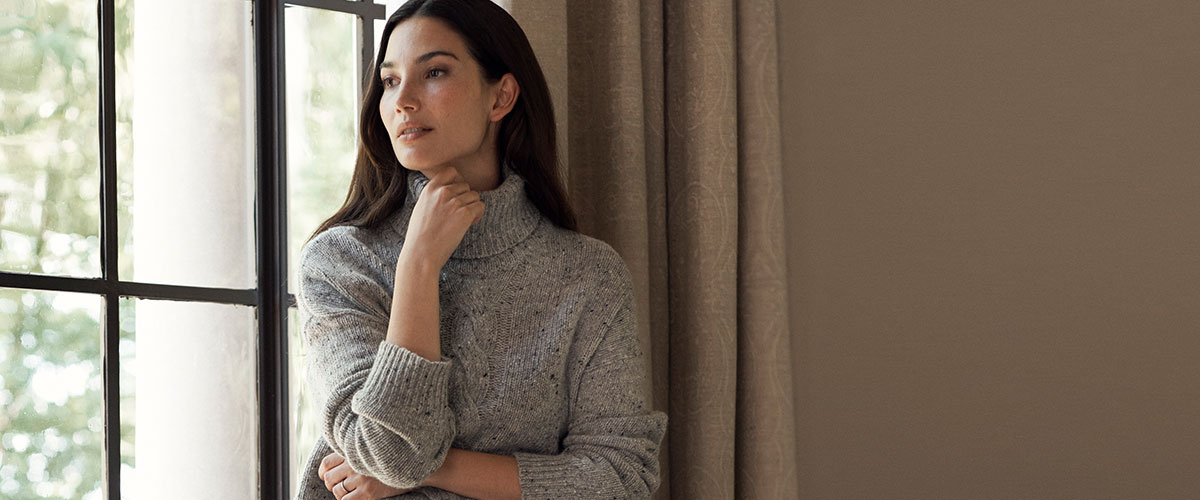Woman in relaxed knit grey turtleneck