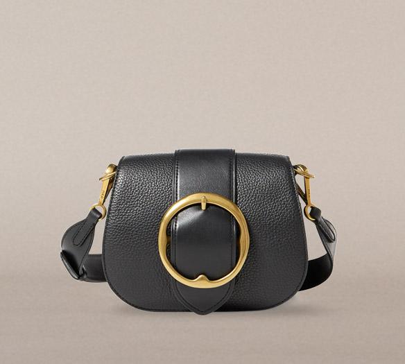 Black pebbled leather shoulder bag with large buckle at front