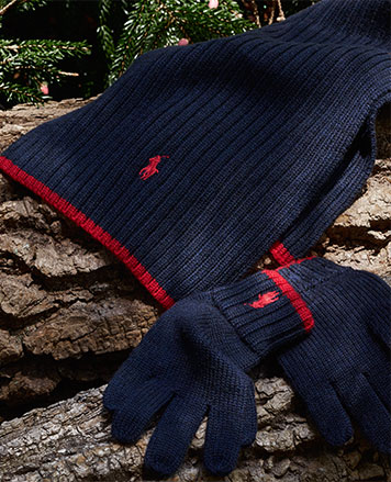 Set of navy hat and gloves with red accents.