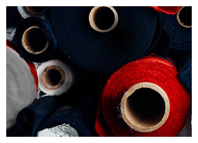 Close-up image of rolls of red, white & blue fabric