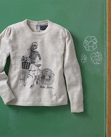 Grey sweater with image of girl riding a bike at the front.