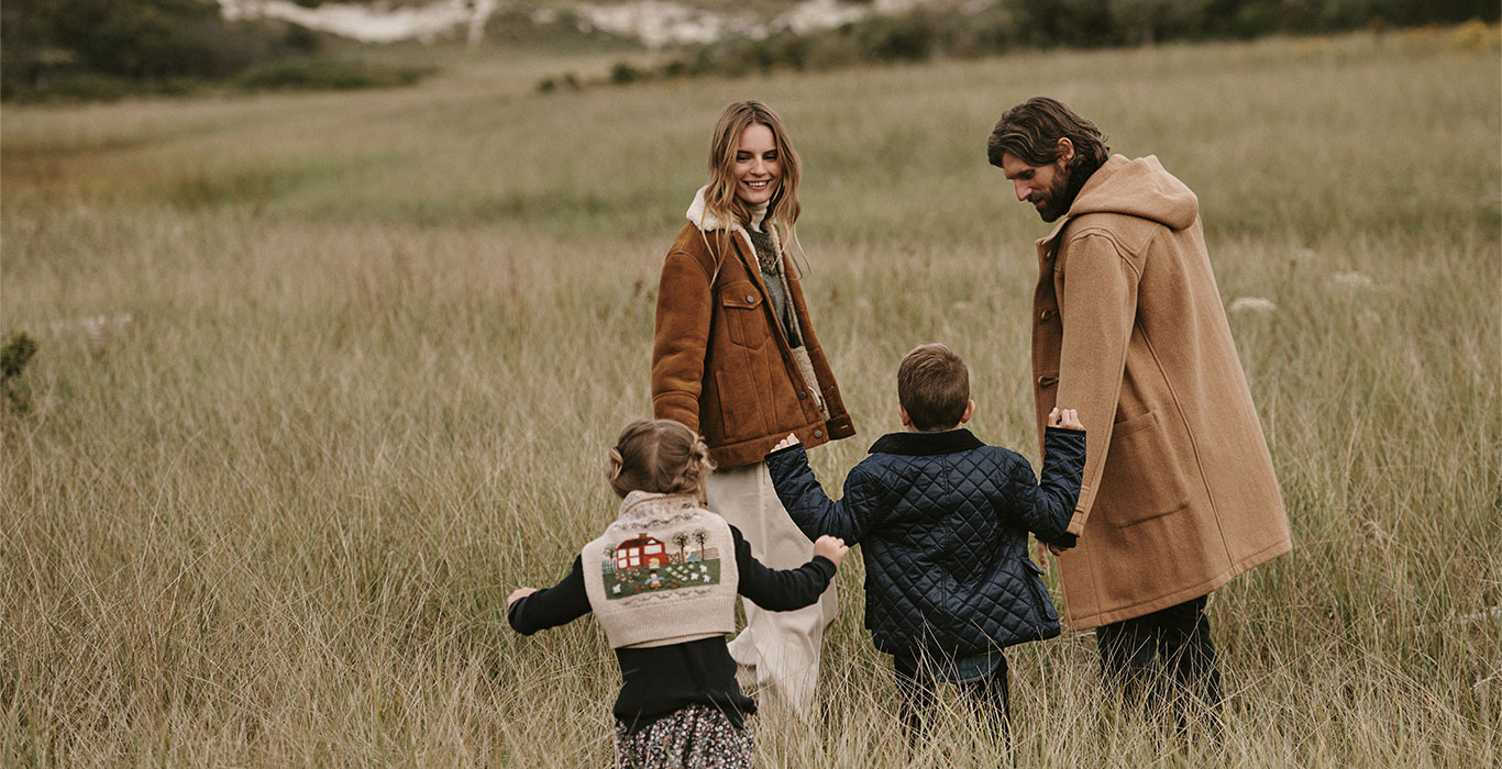 Family in field in Polo styles for fall