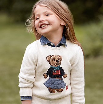 Girl in American flag Polo Bear sweater
