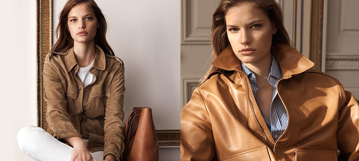 Model in camel coat layered over cream turtleneck & pants