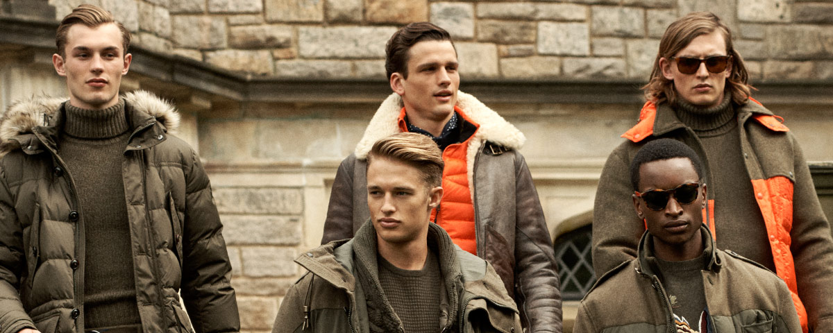 Men in olive-hued & orange-accented outerwear & knitwear
