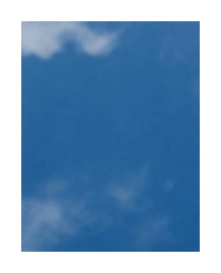 Blue sky with wispy white clouds