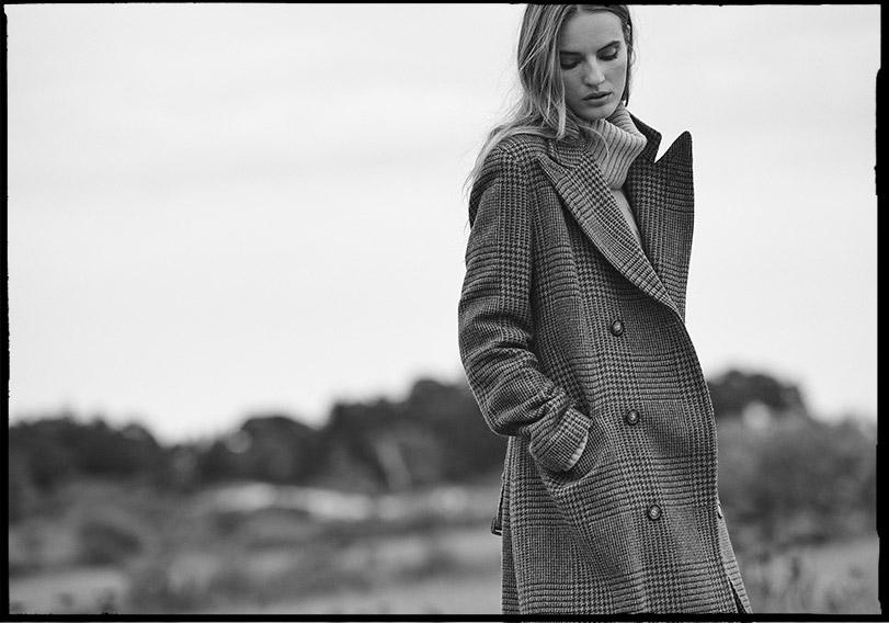 Woman in Glen plaid topcoat