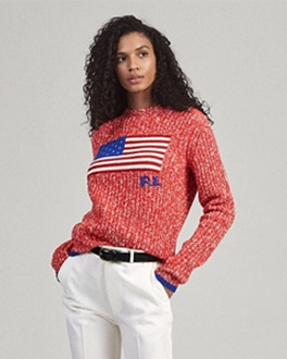Woman in white-flecked red sweater with American flag motif