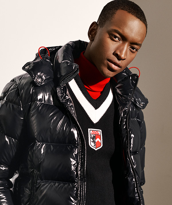 Man in high-shine black quilted down coat