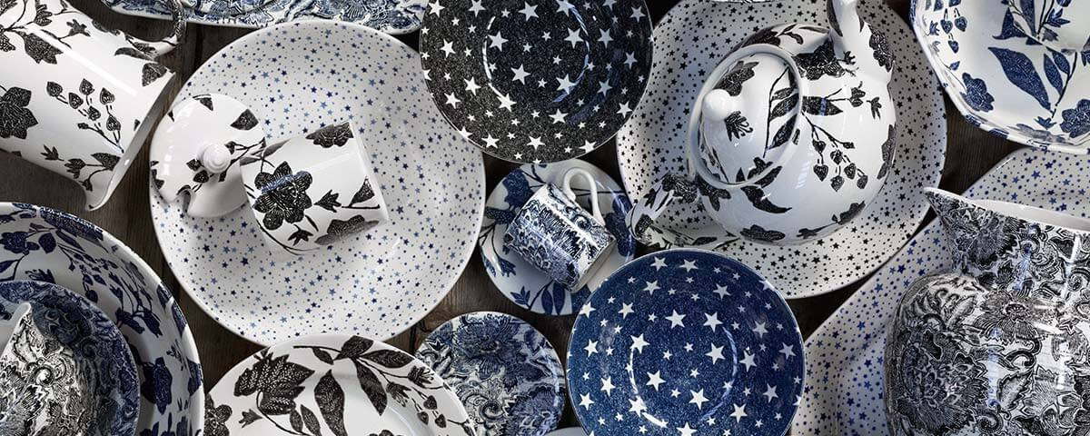 Plates with floral and star patterns in navy & black