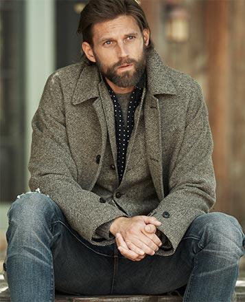 Man in grey herringbone topcoat