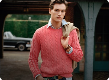 Man in coral pink cable sweater