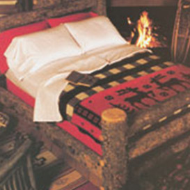Rustic wooden bed with plaid & Western-inspired blankets