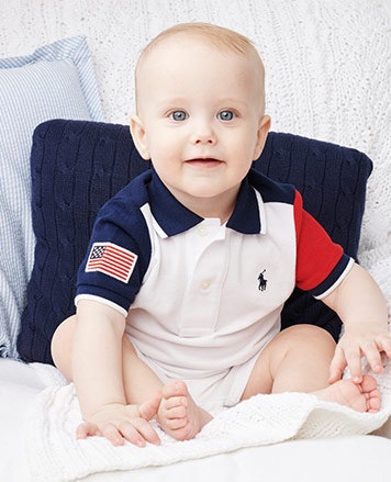 Baby boy in flag patch shortall with navy & red color-blocking