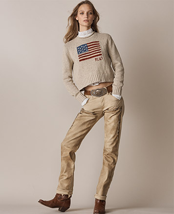 Woman in cropped tan sweater with American flag at front