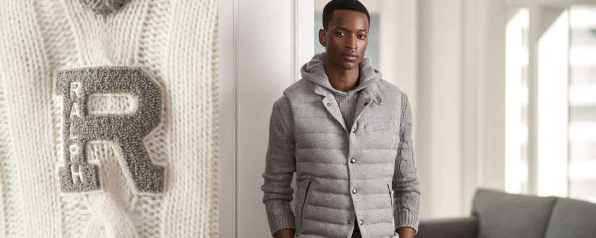 Close-up of white sweater with grey R patch; man in quilted  vest over hooded  sweater.