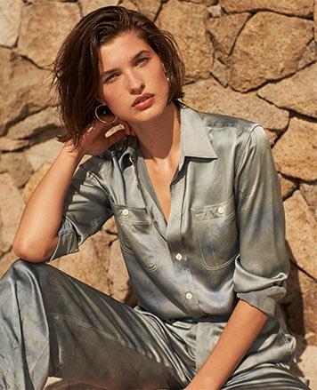 Woman in metallic silver button-down shirt