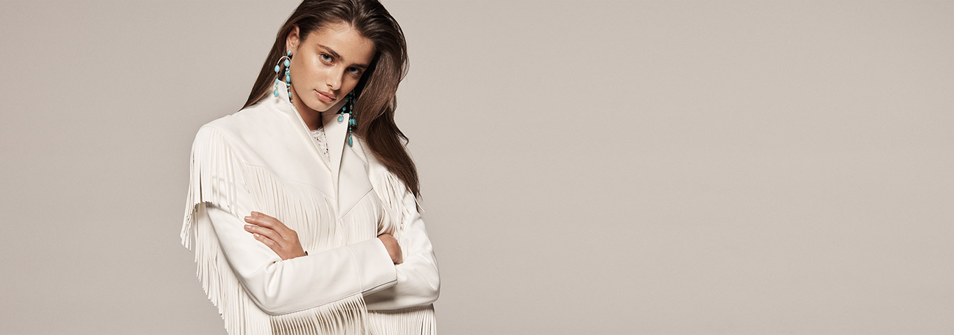 135944af0715 Woman in fringe white leather jacket. Ralph Lauren Collection