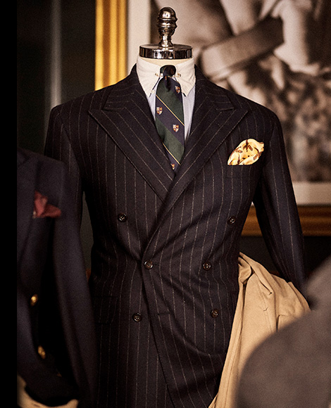 Black pinstripe tuxedo paired with crest club tie
