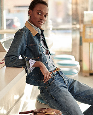 Woman leaning against wall in all-denim look
