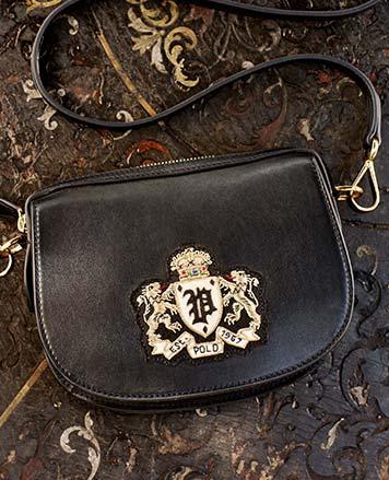 Black shoulder bag with bullion crest at front