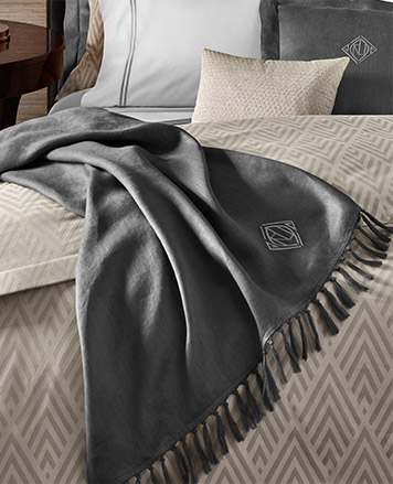 Dark grey blanket with fringe trim & monogram