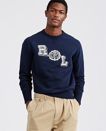 Mode in navy sweatshirt with white RL graphic at front