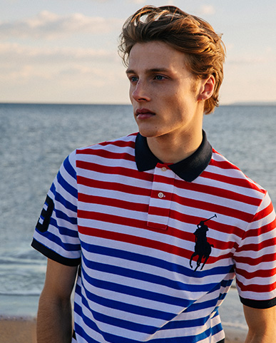 Man in white Polo shirt with red & blue stripes