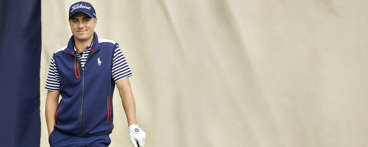 4ba1d621a3f Justin Thomas in navy vest, striped tee & navy pants. Polo Golf Ralph Lauren