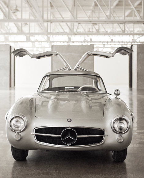 "Photograph of the Mercedes-Benz ""Gullwing"" from front with doors open"
