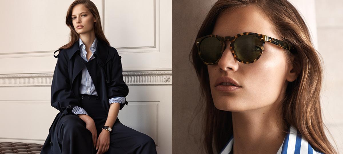 Model in navy trench coat & tortoiseshell sunglasses