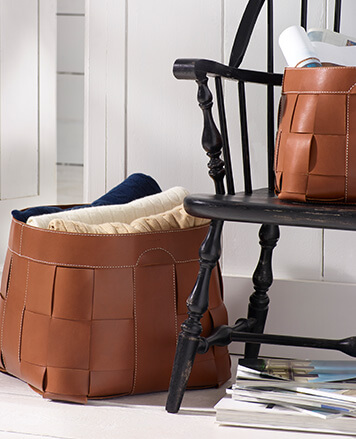Rich brown woven leather blanket bin
