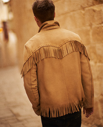 Man wears fringed jacket