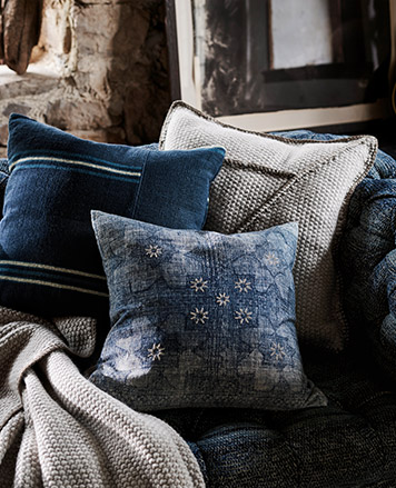 Inigo-dyed throw pillows with stripe & floral accents
