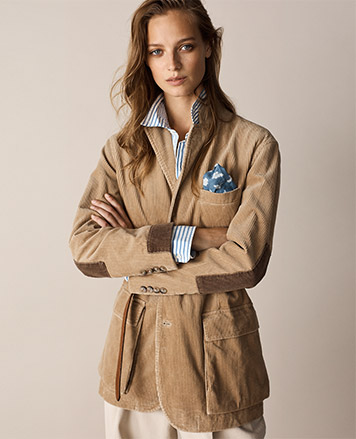Woman in tan corduroy sport coat with contrast elbow patches