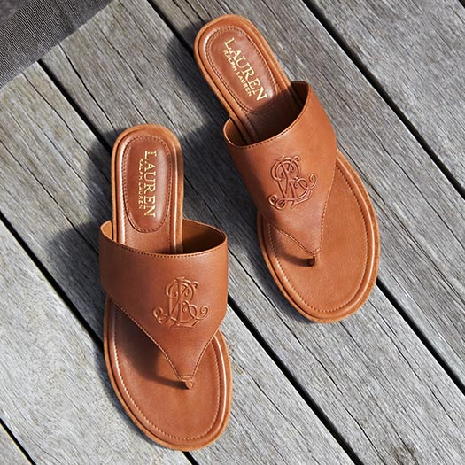 Tan leather thong sandals with a band upper