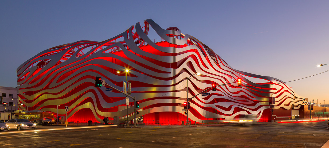 The newly renovated façade of the Petersen Automotive Museum channels automotive speed and power