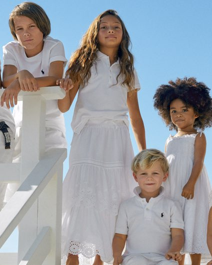 Boys and girls in white Polos, dresses & skirts