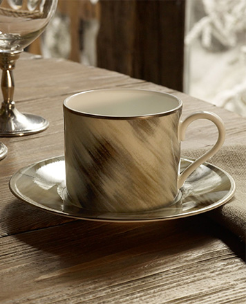 Cup & saucer with a horn-inspired motif