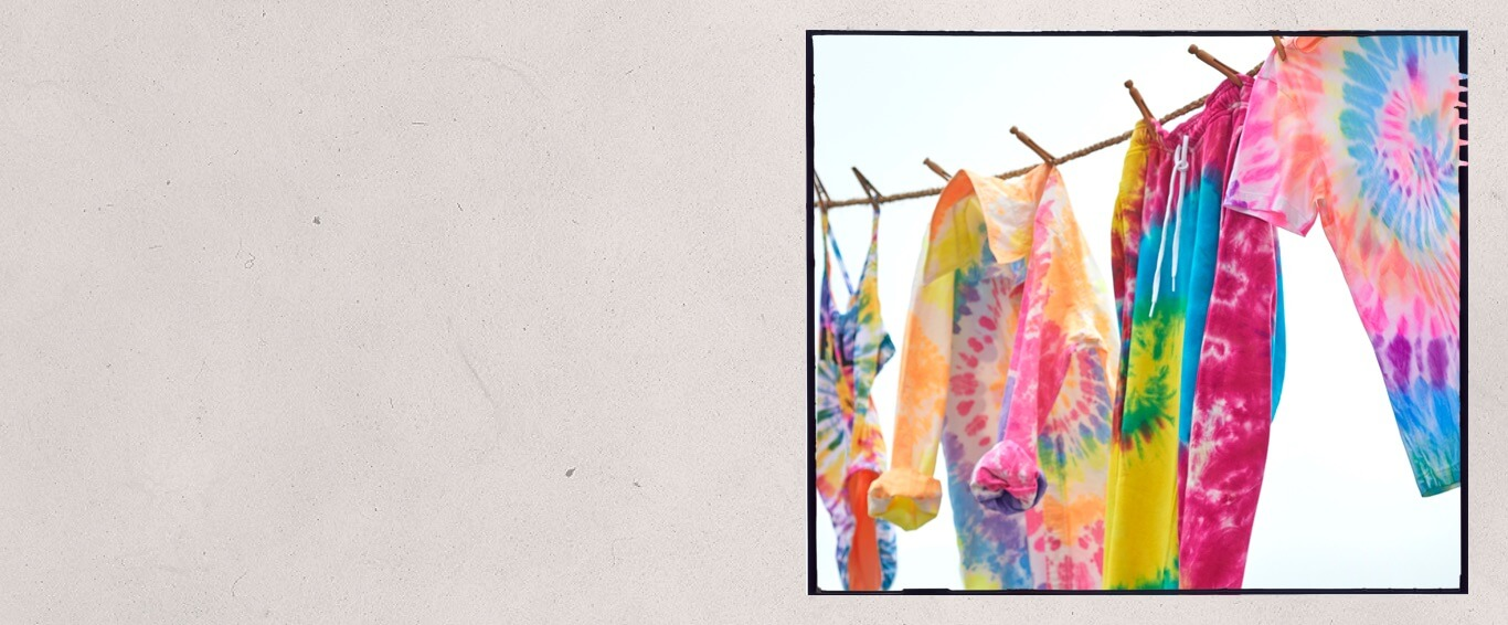 Colorful tie-dye clothes clipped to a clothesline