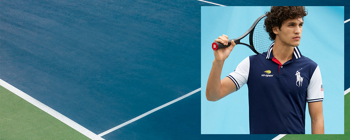 Tennis player in navy US Open Polo shirt with contrast white sleeves