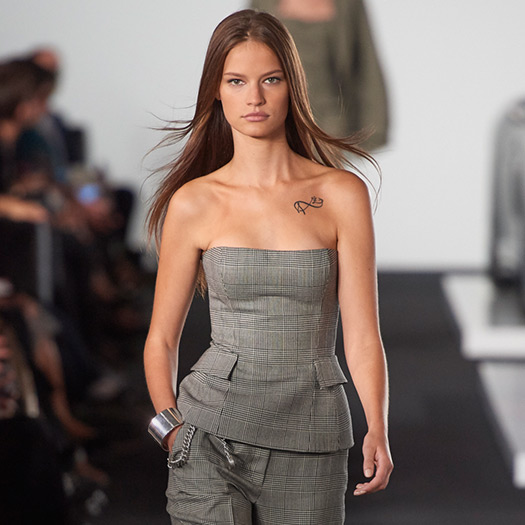 Model walks the runway in Glen plaid bustier & matching trousers