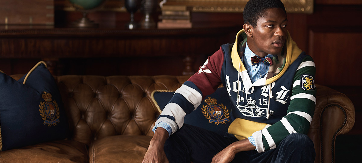 Man in color-blocked hoodie with Polo & collegiate-inspired motifs